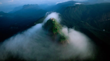 Adam's Peak, in southern Sri Lanka, emerges from the mornng mists.